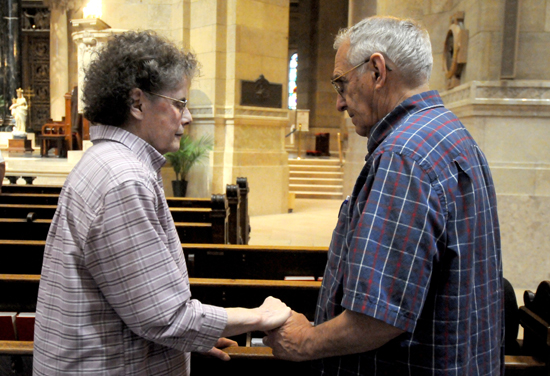 Richard and Pat Erickson, parents of Father John Paul Erickson, held hands as they renewed their vows during the Mass.
