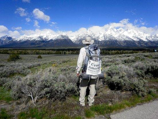 """Daniel Reinke pauses to take in the scenery during his journey. He was inspired to begin this 3,000 mile faith journey after reading """"Rediscover Catholicism"""" by Matthew Kelly. Photo courtesy of Robert Reinke"""