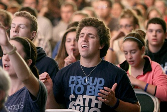 Elijah Flanders of Holy Name of Jesus in Wayzata and a junior at Providence Academy in Plymouth prays during Mass at Archdiocesan Youth Day Sept. 21 at Holy Family High School in Victoria. The day featured guest speaker Sean Forrest, activities, Mass celebrated by Archbishop John Nienstedt and eucharistic adoration. Dave Hrbacek / The Catholic Spirit