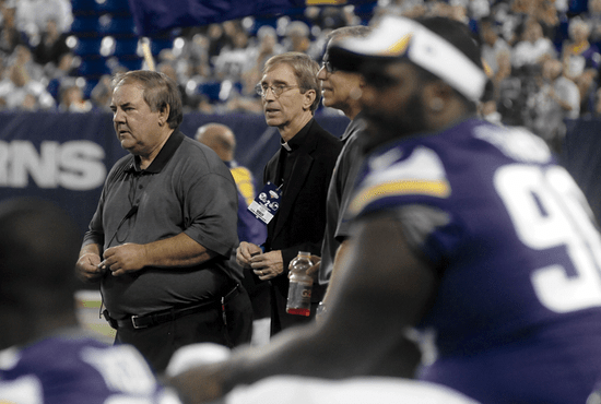 Minnesota Vikings chaplain Father Michael Van Sloun, center, watches the last preseason game from the sideline at the Metrodome in Minneapolis Aug. 29. Father Van Sloun has been one of two chaplains to the team since 2002. Dianne Towalski / The Catholic Spirit