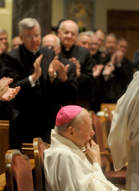 Archbishop John Nienstedt is among the congregation that gave a standing ovation to retired St. Cloud bishop John Kinney during a vespers service Nov. 6 at St. Mary's Cathedral in St. Cloud. The diocese's new bishop, Donald Kettler, was installed the next day. Dianne Towalski / The Catholic Spirit