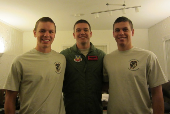 Deacon Paul Shovelain, right, stands last August with his brothers, Dominic, left, and Brian, who is a pilot in the Air Force.  Photo courtesy of Deacon Paul Shovelain