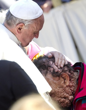 Pope Francis embraces Vinicio Riva, 53, during his general audience in St. Peter's Square at the Vatican Nov. 6. CNS photo/Claudio Peri, EPA