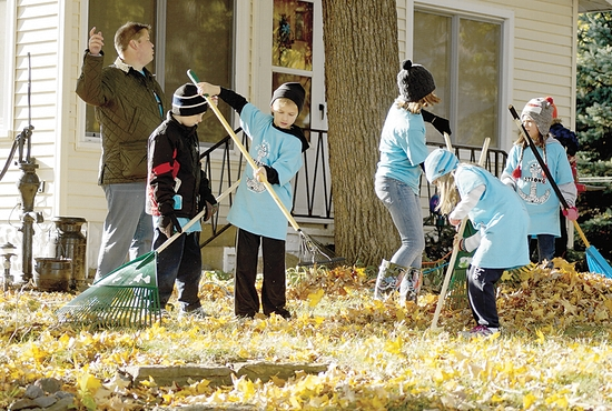 RAKE-A-THON: Students from Our Lady of the Lake Catholic School in Mound raked the yards of local residents and senior citizens in the communities surrounding Lake Minnetonka Oct. 25. This year's Rake-A-Thon, an annual school fundraiser, raised $25,000. Students got pledges from friends, family, and neighbors, to rake yards for those who need assistance doing this fall task. Photo courtesy of Erin Wombacher