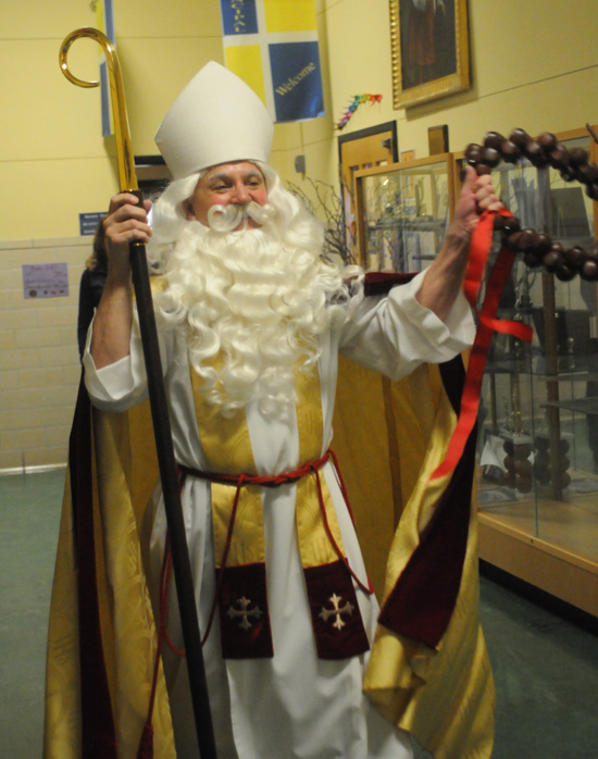 St. Nicholas walks down the hall at St. Thomas More School.