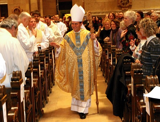 Bishop Cozzens walks the aisles of the Cathedral to give his Episcopal Blessing to the congregation.