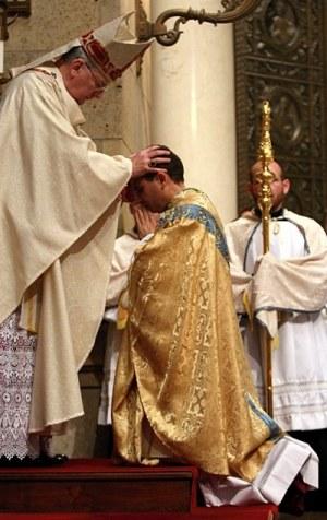 Archbishop Nienstedt lays hands on Bishop Cozzens.