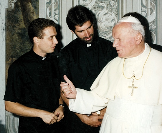Seminarians Andrew Cozzens, left, and Michael Becker (now priests) greet Pope John Paul II in Rome in 1996.