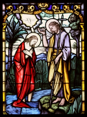Christ's baptism by John the Baptist at the Jordan River is depicted in a stained-glass window at St. Therese of Lisieux Church in Montauk, N.Y.   CNS photo / Gregory A. Shemitz, Long Island Catholic