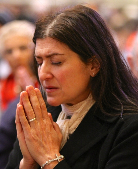 Kate Weber-Choals of the Cathedral of St. Paul prays during the prayer service.