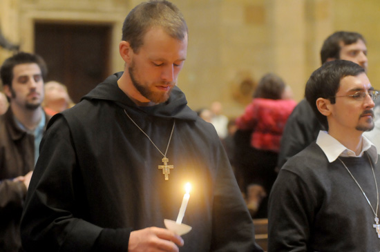 Franciscan Brother of Peace Max Connolly prays after the candlelit procession.