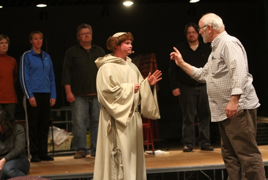 "Patrick Fix, center, of St. Agnes in St. Paul, and Bob Pintozzi, right, of St. Bonaventure in Bloomington rehearse a scene from ""Francesco, the Musical"" at St. Bonaventure. Fix plays Francesco, the main character, while Pintozzi plays the Sultan. Dave Hrbacek / The Catholic Spirit"