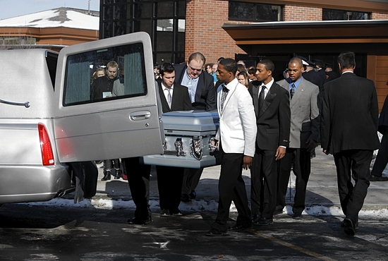 Members of the Silver Lake College of the Holy Family men's basketball team in Manitowoc, Wis., carry the coffin of Stephen Smith after the Jan. 29 funeral Mass for Smith, Tyler Doohan and Lewis Beach at St. John's of Rochester Catholic Church in Fairport, N.Y. CNS photos/Annette Lein, courtesy Democrat and Chronicle Media Group