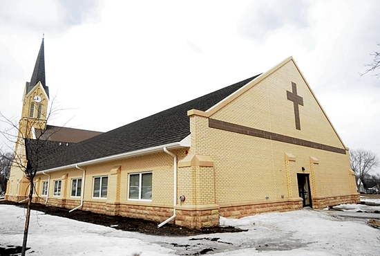The new parish life center includes a gathering space, adoration chapel, offices and six classrooms for the parish school and religious education. A ramp at the entrance makes the church and school wheelchair-accessible.