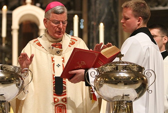 Archbishop John Nienstedt prays during the blessing of the oil of catechumens and consecration of chrism near the end of the 2013 Chrism Mass at the Cathedral of St. Paul. Dave Hrbacek / The Catholic Spirit
