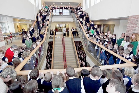 "GRAND OPENING The community of Convent of the Visitation School in Mendota Heights gathered March 17 to celebrate the grand opening of a new multilevel commons area called the Heart of the School, part of the Visitation Heart and Mind building project. The $10.5 million project also includes the Opus Hall for science, technology, engineering and math — which forms the ""mind"" of the project ­— that opened in January 2013. Photo courtesy of Visitation School"