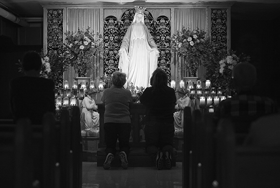 WORSHIPPERS LIGHT CANDLES, PRAY DURING CELEBRATION OF ANNIVERSARY OF APPARITION AT WISCONSIN SHRINE