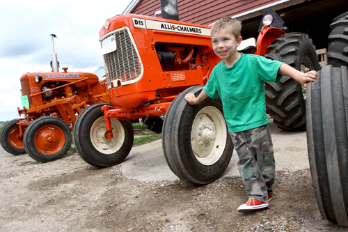 Isaac Marquette of St. Mary in Waverly checks out some vintage tractors. Dave Hrbacek/The Catholic Spirit