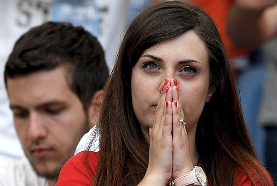 CHARISMATIC PRAYERS A young woman prays before Pope Francis' arrival for an encounter with more than 50,000 Catholic charismatics at the Olympic Stadium in Rome June 1. The pope knelt onstage as the crowd prayed over him by singing and speaking in tongues. During the event, the pope acknowledged he had once been uncomfortable with the charismatic movement. CNS photo/Paul Haring