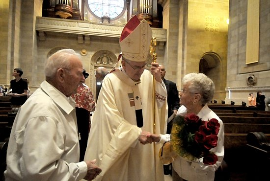 Archbishop John Nienstedt visits with Vincent and Leona Arceno of St. Pascal in St. Paul after the Mass. They were recognized during the Mass for celebrating 71 years of marriage.