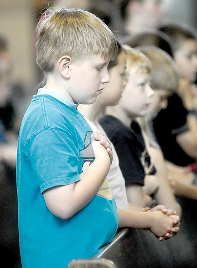 Carter Pitt prays during Mass July 11.