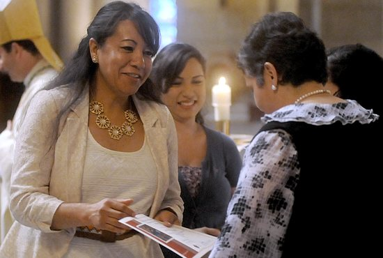 Biblical Institute graduate Lorena Martínez López of Our Lady of Guadalupe in St. Paul receives her diploma after being greeted by Bishop Andrew Cozzens July 26 at the Cathedral of St. Paul.