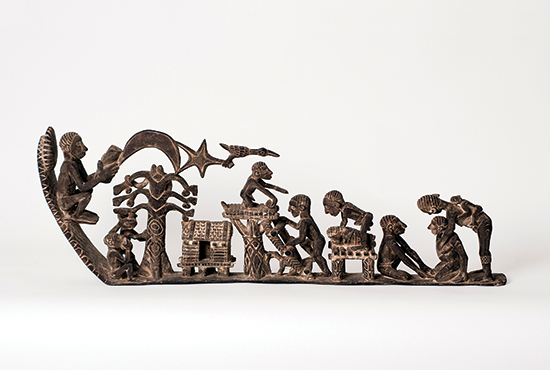 """Genesis,"" by Asmat artisan Aleksander Wuru, a 5-foot long single piece of ironwood, elaborately tells the Christian story of creation, the temptation in the Garden of Eden, birth and death, within the context of Asmat culture. Photo courtesy American Museum of Asmat Art"