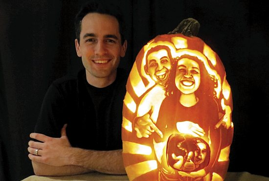"A HALLOWEEN TREAT Jake (shown) and Shannon Voelker, parishioners of St. Joseph in West St. Paul, announced their pregnancy Oct. 31 on a pumpkin that Jake carved and shared on social media. ""I'm really excited that it's finally public news. It was a perfect reveal,"" said Shannon, who is due April 1. (No joke!) Jake has carved a number of creative pumpkins, including Pope Francis. ""I wanted this pumpkin to really convey to our family and friends how excited and happy we are that God has given us a little life to take care of, and I hope it might remind people in some small way that every life, young or old, is precious and a gift from God,"" Jake said. Their announcement comes at the end of Respect Life Month. Congratulations and God bless, Jake and Shannon! Photo courtesy of Jake Voelker/jakevoelker.com"