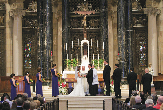 Irene and Scott Mathieson exchange vows during their wedding Mass Aug. 30 at the Cathedral of St. Paul. Dave Hrbacek/The Catholic Spirit