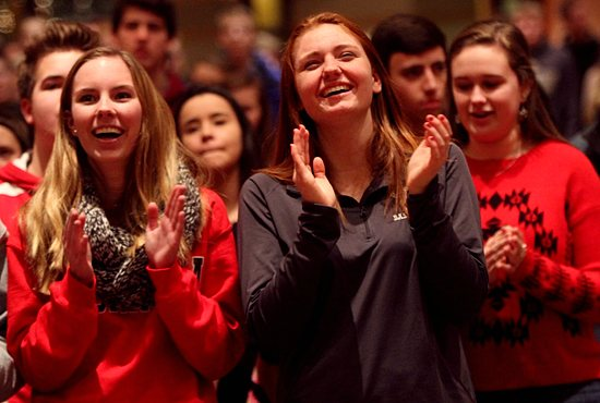 From left, Olivia Kettleson and Abbey Baumtrog sing and clap during praise and worship at Holy Name of Jesus in Wayzata Jan. 11 during an event to help teens in the parish prepare for confirmation. The featured speaker was Father Michael Schmitz of the Diocese of Duluth, who also celebrated the 5:30 p.m. Mass. Dave Hrbacek/The Catholic Spirit