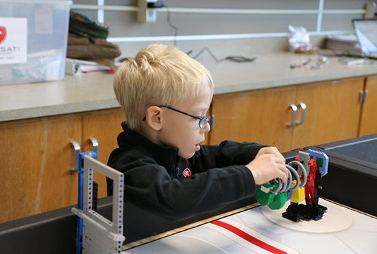 At Frassati Catholic Academy in White Bear Lake, the archdiocese's newest Catholic school, a STREAM curriculum engages students, including third-grader Christopher Wicks in hands-on learning that touches on multiple subject areas.  Photo courtesy Frassati Catholic Academy