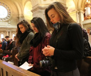 From left, Olivia Illi, Mara Yapello and Izzi Boo of St. Jude of the Lake in Mahtomedi join with others in prayer at the Cathedral of St. Paul during the Prayer Service for Life. They all are students at Mahtomedi High School and run Students for Life at their school.  Dave Hrbacek/The Catholic Spirit