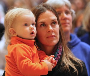 Aja Vogel of St. Peter in Forest Lake and her son Ryker listen to Bishop Lee Piché during the Prayer Service for Life.  Dave Hrbacek/The Catholic Spirit