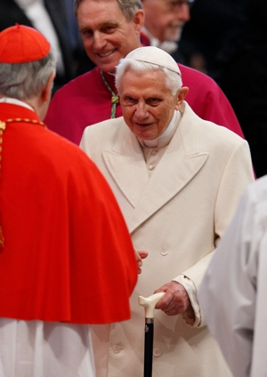 Retired Pope Benedict XVI greets a cardinal before a consistory at which Pope Francis created 20 new cardinals in St. Peter's Basilica at the Vatican Feb. 14. CNS photo/Paul Haring