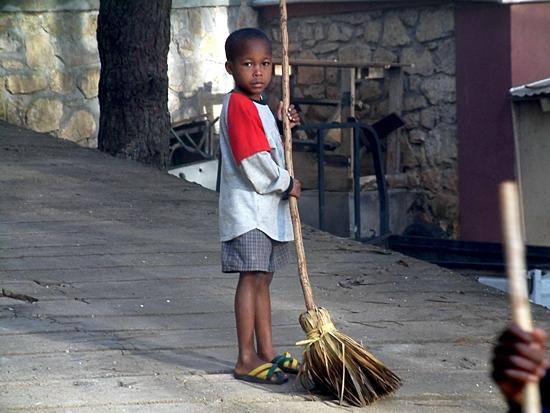 A boy in NPH's Haiti home does chores in this 2003 photo. Photo courtesy NPH USA