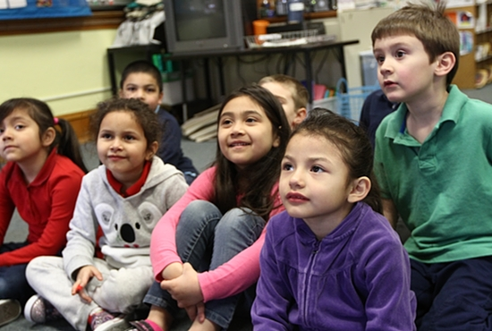 In this 2014 photo, preschool students at St. Bernard Catholic School in Cologne listen to a story. The pre-kindergarten-through-eighth-grade school will close at the end of the school year. Dave Hrbacek/The Catholic Spirit
