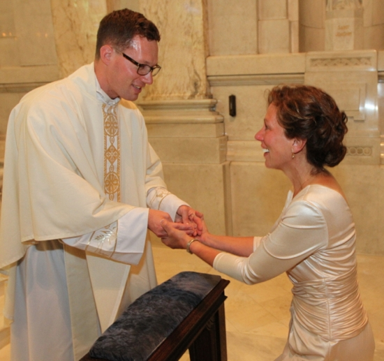 Father Jake Anderson greets his mother, Lori Faymoville, after the ordination Mass. Dave Hrbacek/The Catholic Sister