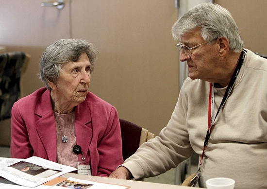 St. Joseph of Carondelet Sister Ann Michele Jadlowski talks with Larry Celski of St. Adalbert in St. Paul during a Caritas session at St. Joseph Hospital in St. Paul. The group meets to help those affected by cancer. Dave Hrbacek/The Catholic Spirit