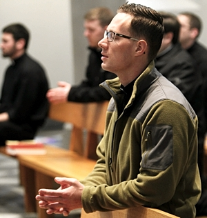 Deacon Jake Anderson takes a moment to pray before Mass at the St. Paul Seminary chapel. Dave Hrbacek/The Catholic Spirit