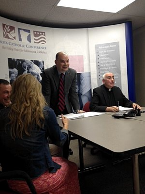 "Jason Adkins, executive director of the Minnesota Catholic Conference, left, and Bishop Donald Kettler of St. Cloud participate in an MCC-sponsored panel June 18 on Pope Francis' encyclical ""Laudato Si: on Care for Our Common Home"" at its St. Paul office. Jessica Trygstad/The Catholic Spirit"