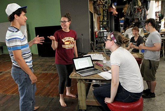 "From left, Marcus Lotti, Fiona Lotti, Erin Cargill and Sandy Hitchin talk things over during a rehearsal of ""Tales From Café Inferno"" July 10 at Bedlam Design Center in Minneapolis. Fiona Lotti and Hitchin co-wrote the show, with Lotti serving as director and producer. The group will perform during the annual Fringe Festival in Minneapolis July 30 through Aug. 9. Dave Hrbacek/The Catholic Spirit"
