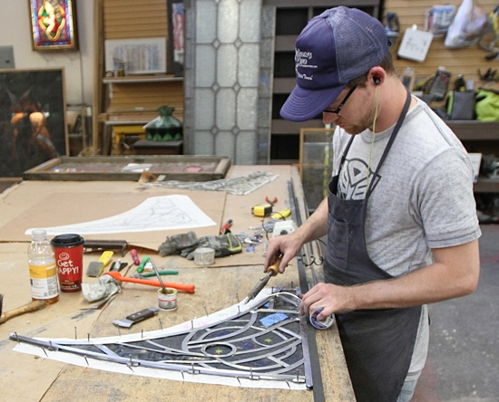 Craftsman Joey Leto of Gaytee-Palmer Stained Glass in Minneapolis rebuilds a window from the Cathedral of St. Paul that was removed for repair. Dave Hrbacek/The Catholic Spirit