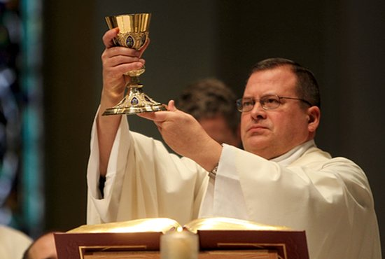 Father Jeffrey Huard, director of spiritual formation at the St. Paul Seminary School of Divinity in St. Paul, celebrates Mass April 14 with a chalice from St. Timothy in Maple Lake used to pray for vocations as part of the seminary's new initiative. Dave Hrbacek/The Catholic Spirit