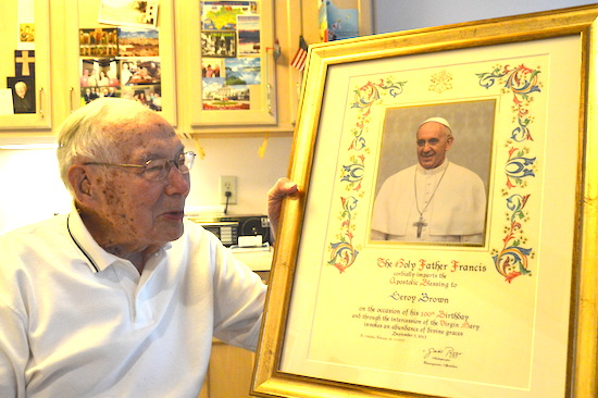 LeRoy Brown holds the framed congratulatory letter he received from Pope Francis upon his 100th birthday nearly two years ago. Longtime St. Thomas Academy teacher and veteran lobbyist for Catholic issues, Brown turns 102 on Sept. 7.