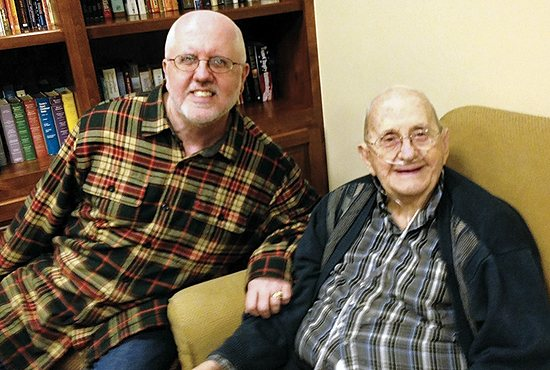 Richard G. Evans, left, visits with his father, Donald, at a gathering Dec. 20, 2014.  Courtesy Richard G. Evans