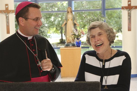 Mary Jo Copeland celebrates during the dedication of a new addition to Mary's Place Aug. 25, which featured Bishop Andrew Cozzens. Copeland, her husband Dick and Bishop Cozzens are scheduled to have a private audience with Pope Francis Sept. 24 at the Vatican Embassy in Washington, D.C.