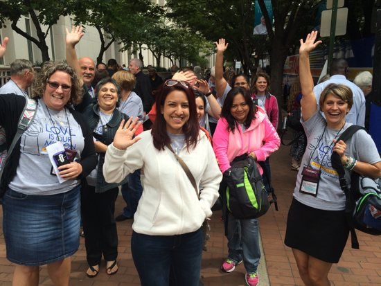 Pilgrims wave after arriving at the Pennsylvania Convention Center Sept. 22. From left, Emily Klinker, Beatriz Lopez, Leila Rodriguez, Maureen Portilla and Jean Stolpestad. Maria Wiering/The Catholic Spirit