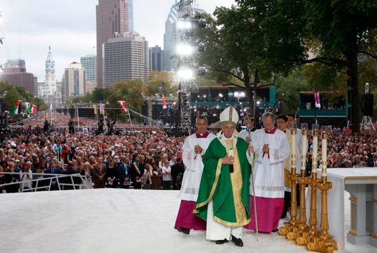 Pope Francis arrives to celebrate the closing Mass of the World Meeting of Families on Benjamin Franklin Parkway in Philadelphia Sept. 27. CNS photo/Paul Haring