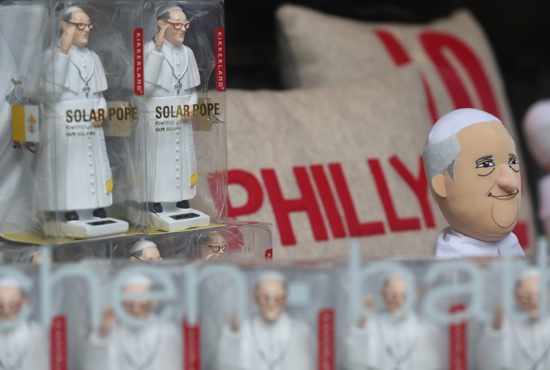 Pope Francis figurines are seen in a window display at a store along a street in Philadelphia. The pope will visit Philadelphia during his Sept. 22-27 trip to the United States. CNS/Bob Roller