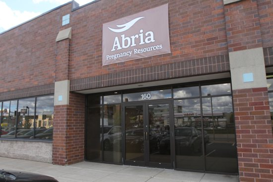A temporary sign marks the recently opened Abria Pregnancy Resources Oct. 15 on University Avenue in St. Paul. Dave Hrbacek/The Catholic Spirit